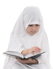 Little Muslim Girl Reading Quran