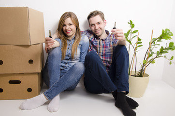 Young happy couple moving in
