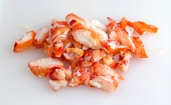 Chunks of lobster meat on cutting board