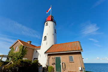 Fototapete - white old lighthouse in Urk