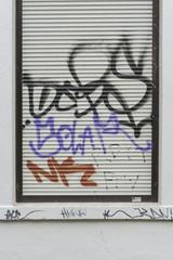 Graffiti auf einem Rolladen