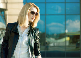 Beautiful stylish woman in trendy sunglasses and leather jacket