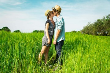 Couple in love is kissing in the country side