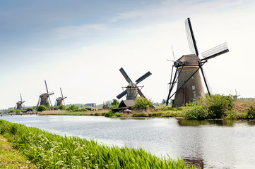 Windmills next to a channel in Kinderdijk, The Netherlands