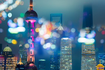 Aluminium Prints Shanghai Blurred city lights and office buildings
