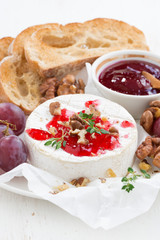 camembert with berry jam and toasts, vertical