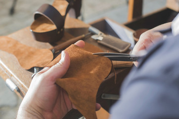 Hands making shoes