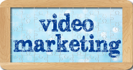 jigsaw puzzle of video marketing in wooden frame