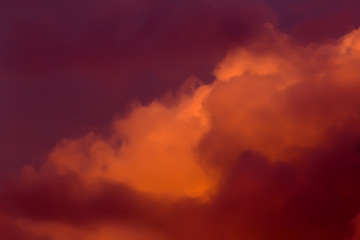 Lush clouds in fiery red tones