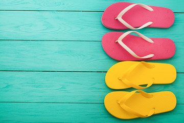 Flip flops on blue wooden background