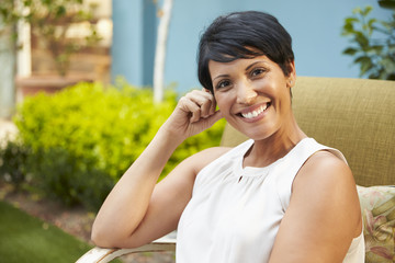 Portrait Of Mature Woman Relaxing Outdoors In Garden