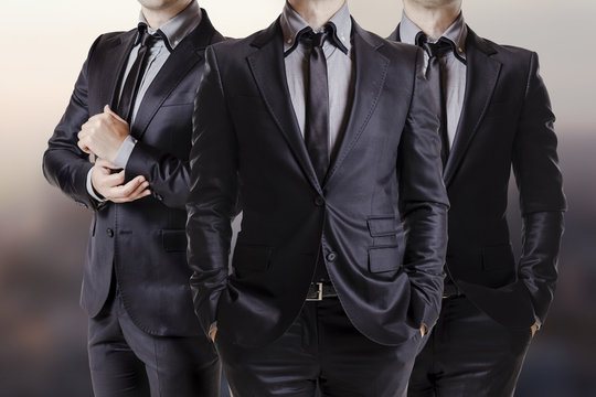 Close up image of three business men in black suit