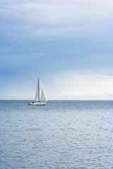 Poster de jardin Voile Sailing boat at an open sea