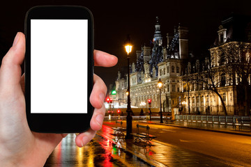 tourist photographs of City Hall in Paris at night