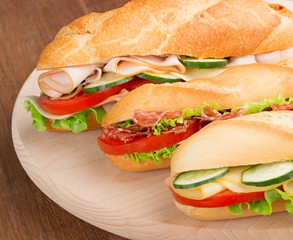 sandwiches with savory fillings on a cutting board