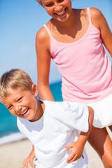 Kids having fun at tropical beach