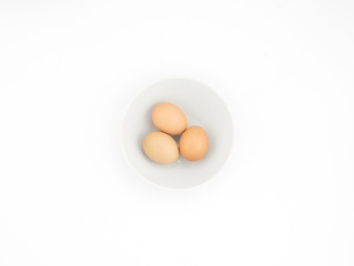 Eggs in white bowl isolated on white background