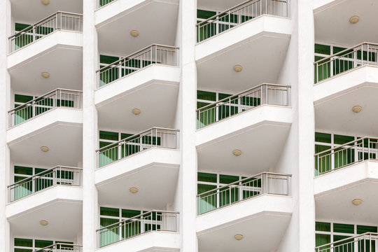 repeating pattern of windows and balcony. Bulding front