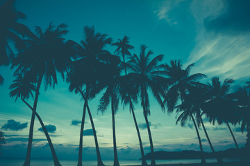 Retro stylized palm trees on tropical beach