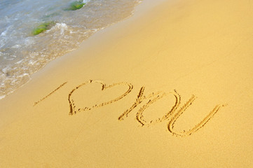 Inscription I love you on a sandy beach