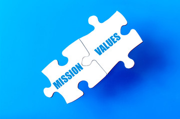 Connected puzzle pieces with words MISSION and VALUES