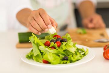 man preparing green salad