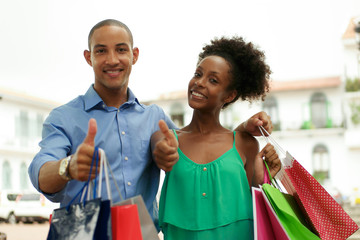 Portrait African American Couple Shopping Smiling With Thumb up