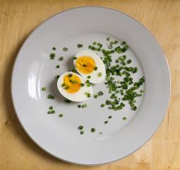 Boiled egg halves on a white plate