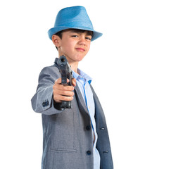 Gangster boy shooting with a pistol