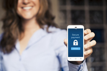 Secure payment message. Woman showing her mobile phone.