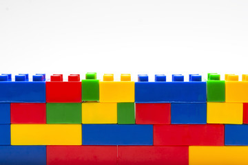 Wall made from plastic building blocks.