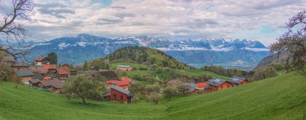 Lovely village on green pastures of Swiss