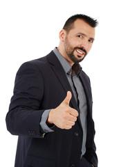 Businessman making thumb up sign