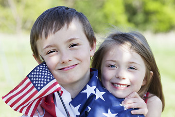 4th of july holiday: happy children with American flag