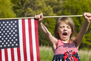 Patriotic holiday child with American flag for july 4th