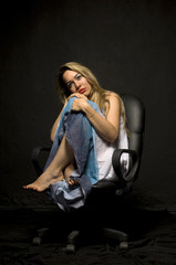 Lonely blonde woman sitting