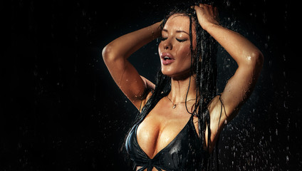 Sexy brunette woman in rain.