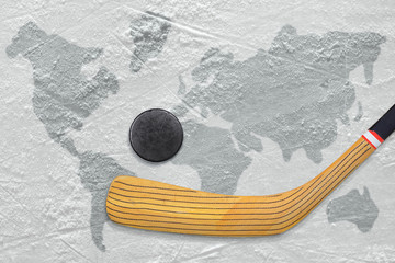 Hockey stick and puck on the ice