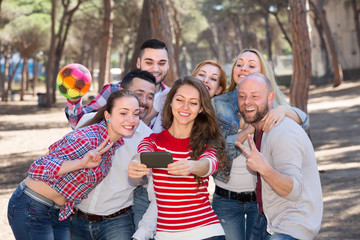 Adults doing selfie outdoors