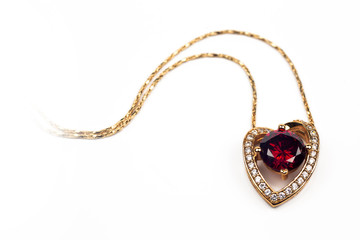heart shaped pendant with red stone