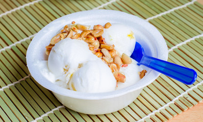 Coconut ice cream homemade with roasted peanuts