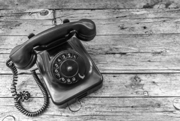 Old telephone on wooden background