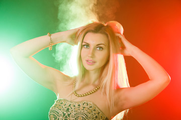 Beautiful young woman between red and green lights