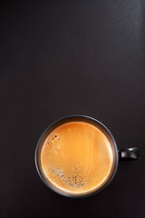 Espresso on a black background. top view