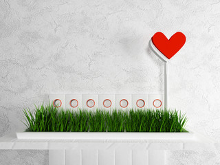 grass and a heart on the shelf