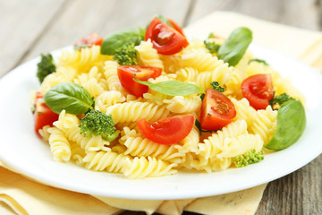 Delicious pasta on plate on grey wooden background