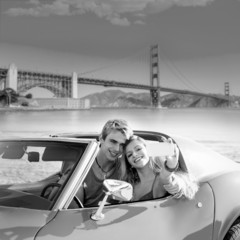 selfie of young couple convertible car Golden Gate