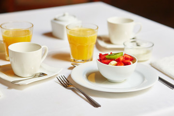 Delicious breakfast with fresh fruits