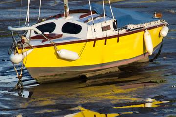 Stranded Yellow Sailing Yacht