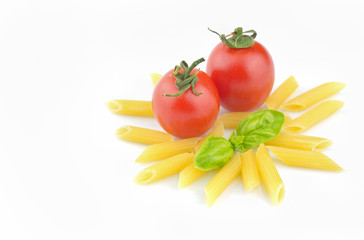 Pasta, fresh tomatoes and basil on white background